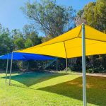 Hip and ridge style school shade structures